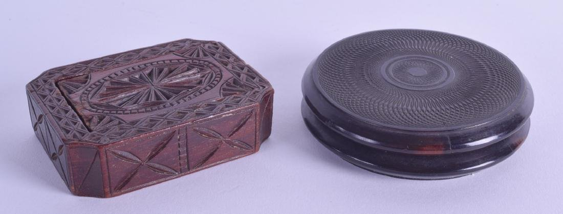 TWO ANTIQUE CARVED WOODEN SNUFF BOXES. Both 8 cm wide.