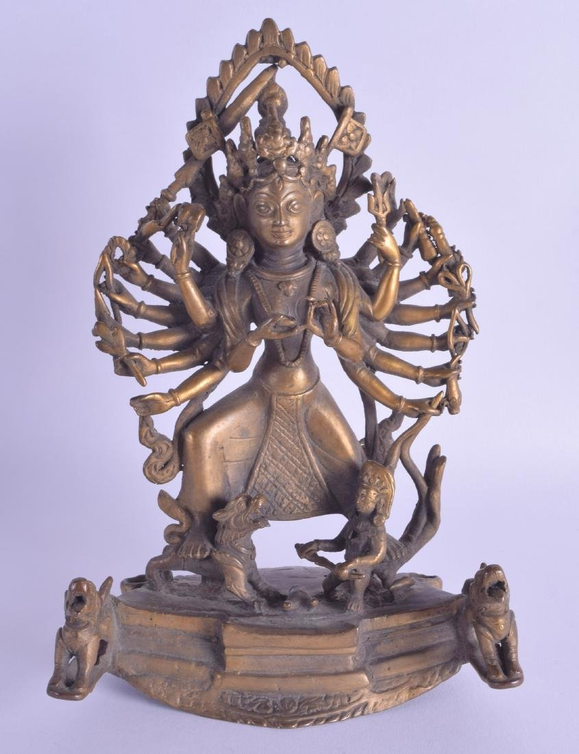AN INDIAN BRONZE FIGURE OF A GOD modelled as a
