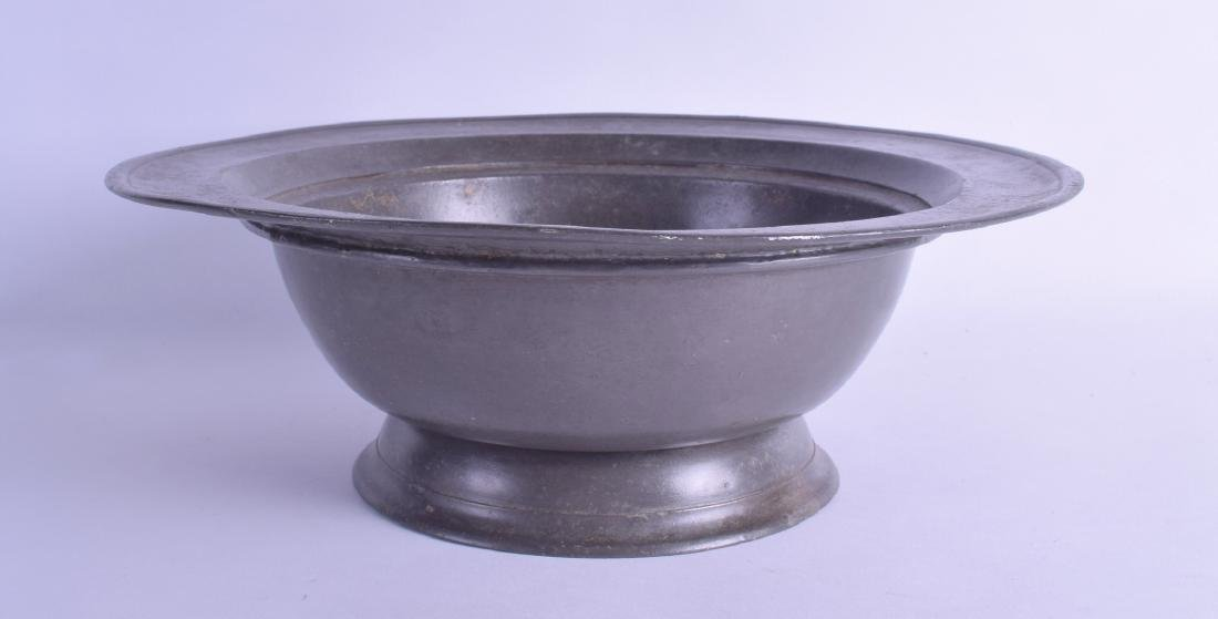 AN EARLY PEWTER PEDESTAL BOWL stamped London & Henry,