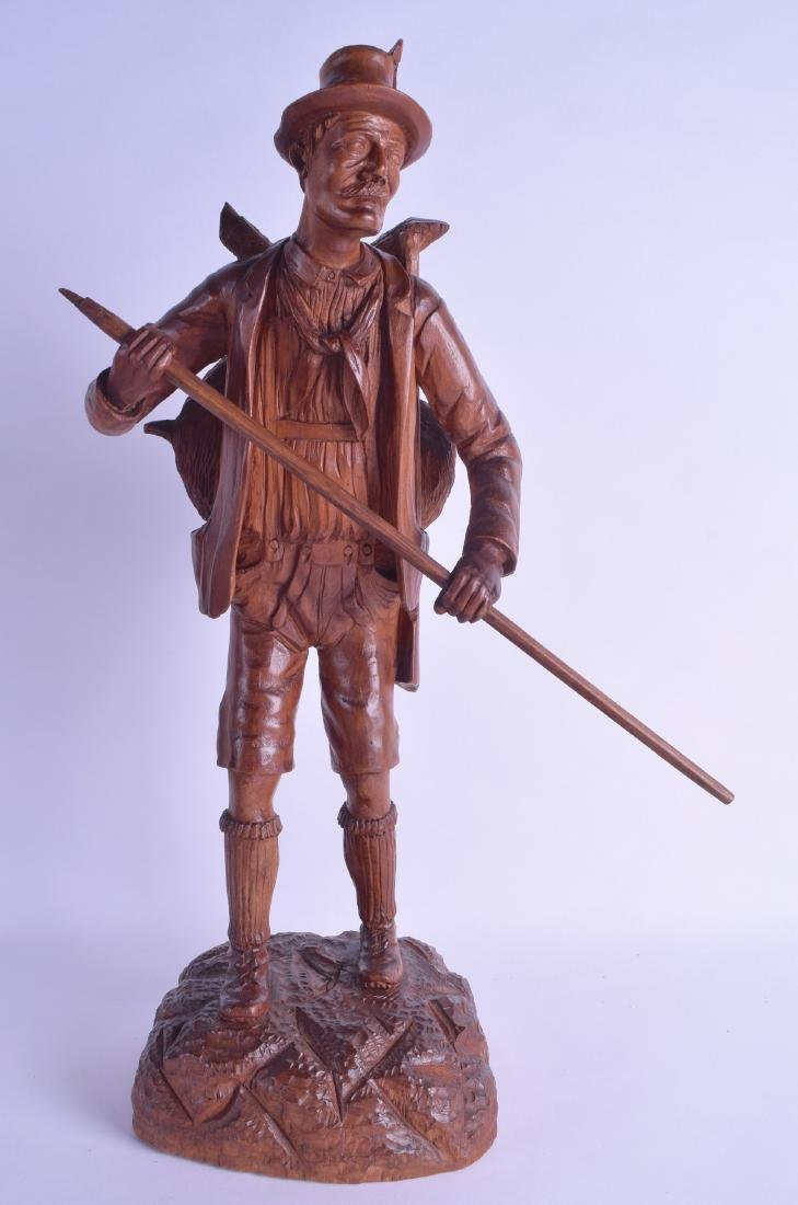 A LARGE EARLY 20TH CENTURY BAVARIAN BLACK FOREST FIGURE