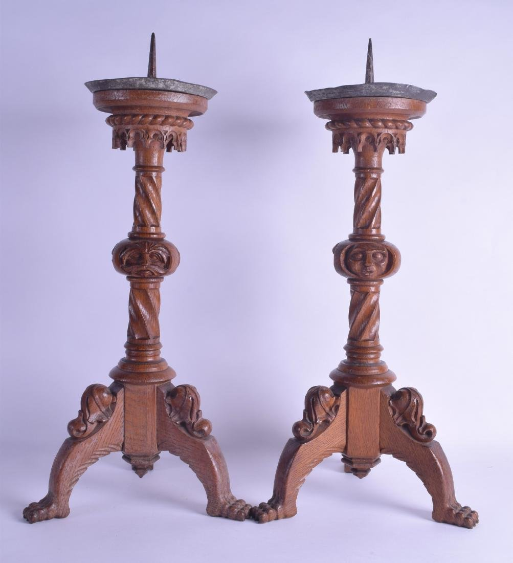 A PAIR OF 19TH CENTURY GERMAN CARVED OAK PRICKET