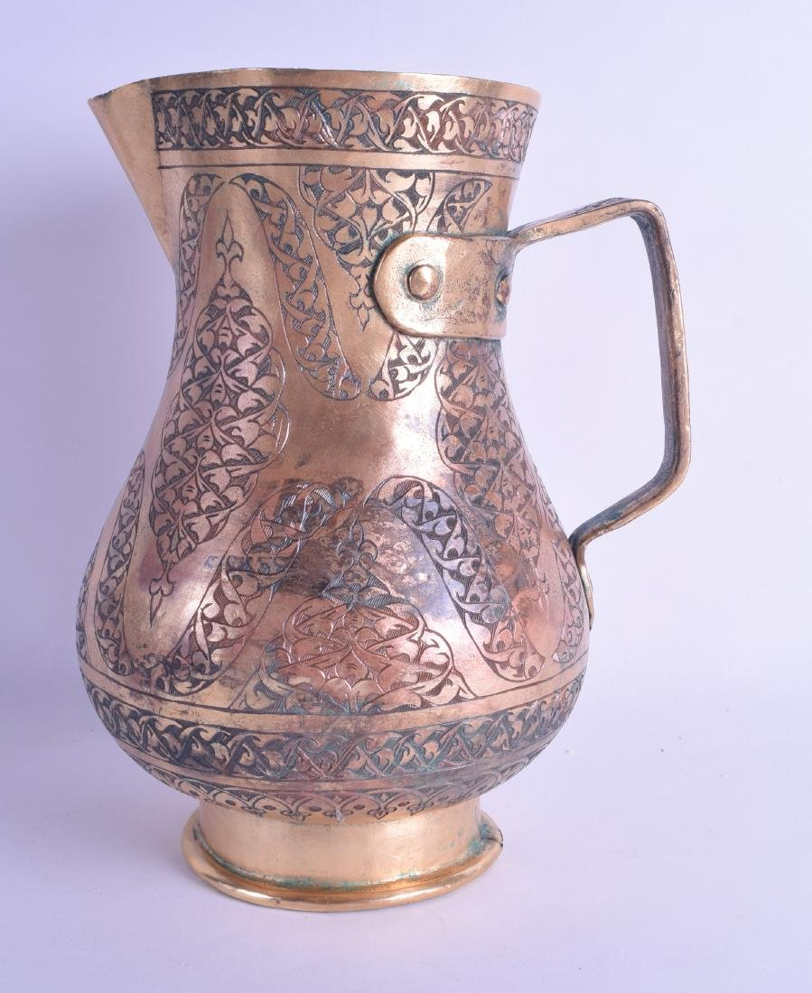 A MIDDLE EASTERN OTTOMAN GILDED COPPER WATER JUG