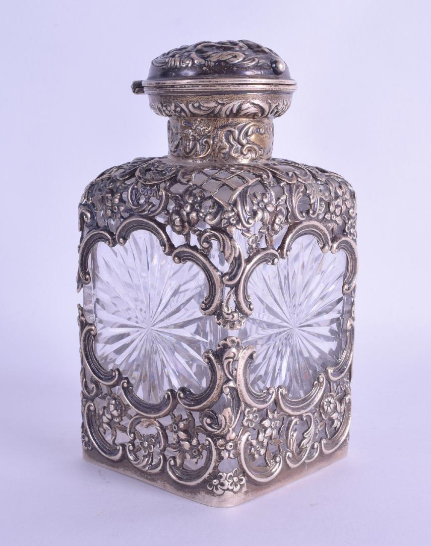 AN EDWARDIAN SILVER MOUNTED GLASS DRESSING TABLE BOTTLE