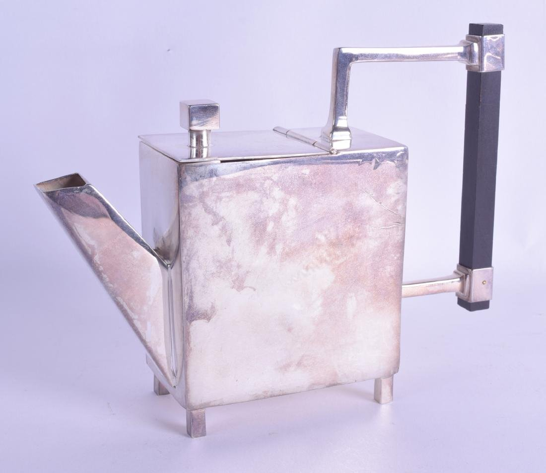 AN ART DECO STYLE SILVER PLATED TEAPOT in the manner of