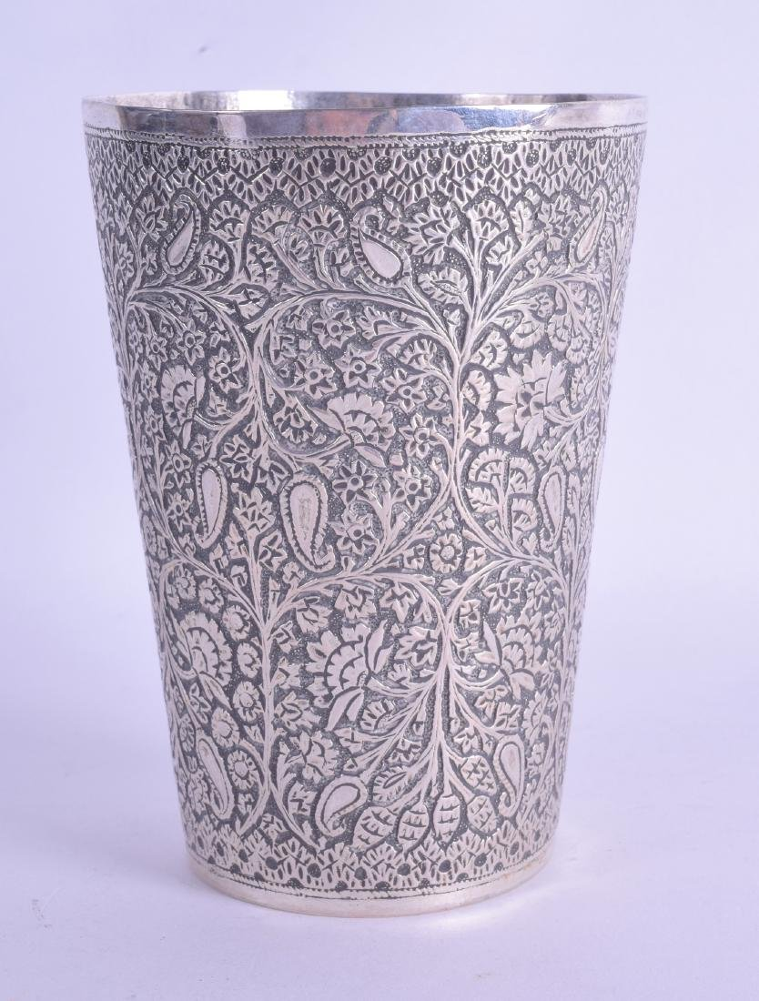 A 19TH CENTURY INDIAN SILVER BEAKER decorated in relief