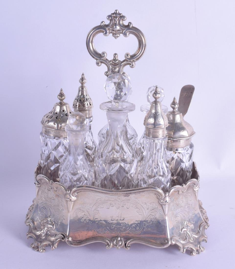 A GOOD VICTORIAN SILVER AND CUT GLASS CRUET SET of