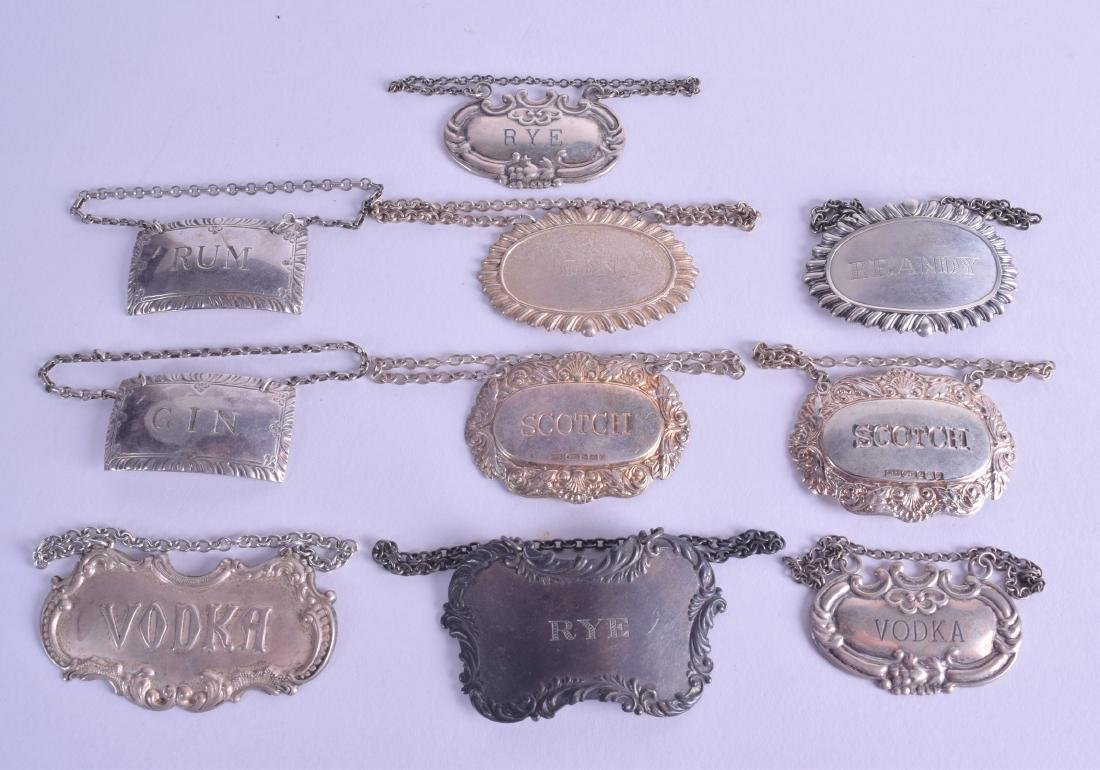 A COLLECTION OF TEN ANTIQUE SILVER DECANTER LABELS of