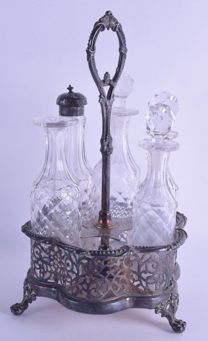 A MID VICTORIAN SILVER CRUET SET with open work body
