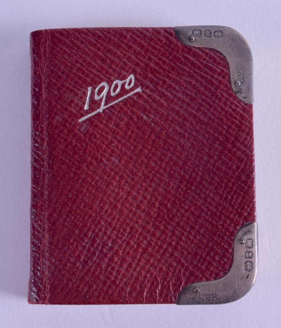 A SMALL EDWARDIAN SILVER MOUNTED LEATHER DIARY.