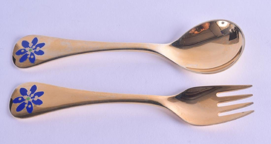 A STYLISH PAIR OF GEORG JENSEN SILVER GILT AND ENAMEL