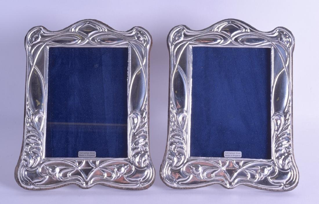 A PAIR OF MODERN ENGLISH SILVER PHOTOGRAPH FRAMES