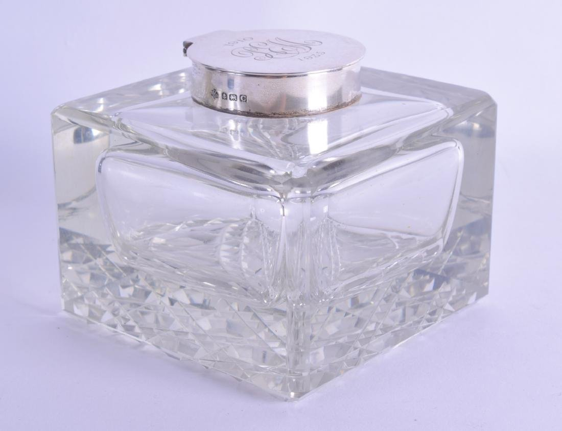 AN ART DECO SILVER TOPPED GLASS DESK INKWELL.