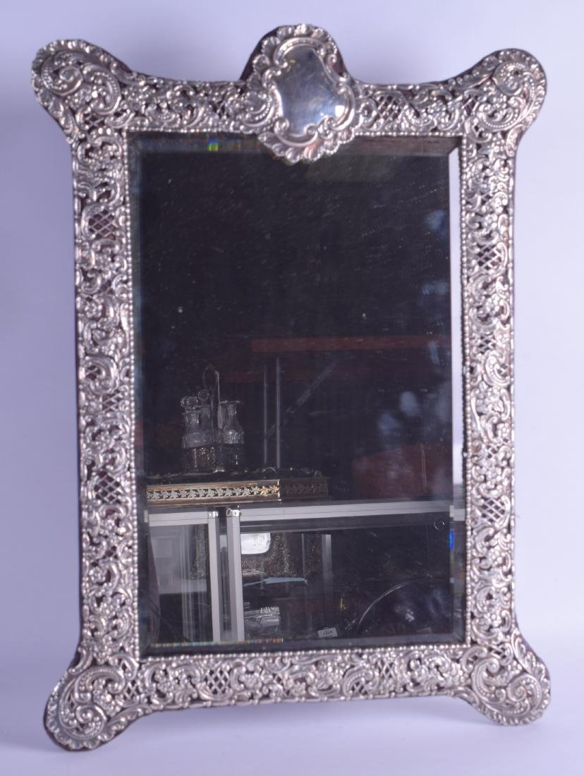 A VERY LARGE EARLY 20TH CENTURY ENGLISH SILVER MIRROR