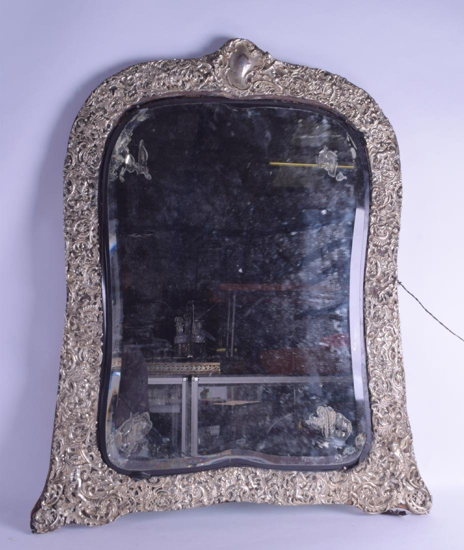 A HUGE LATE 19TH CENTURY ENGLISH SILVER MIRROR by