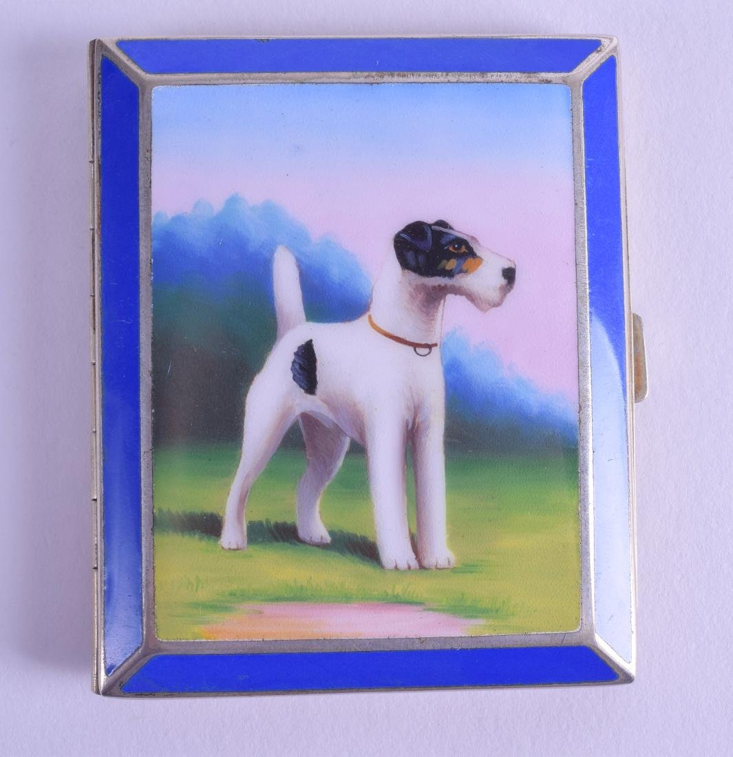 AN ART DECO WHITE METAL GOLD CASED ENAMEL CIGARETTE BOX