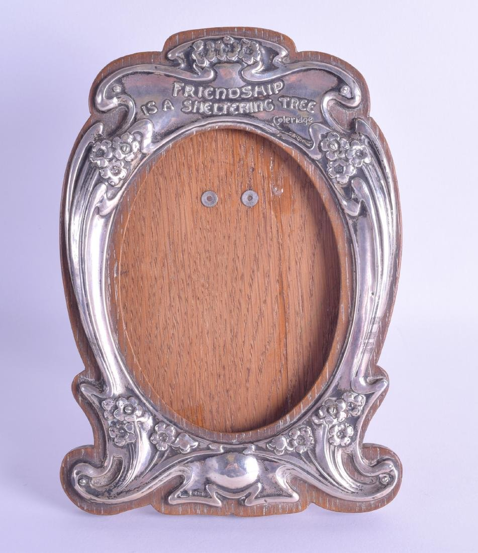 AN ART NOUVEAU SILVER PHOTOGRAPH FRAME decorated with