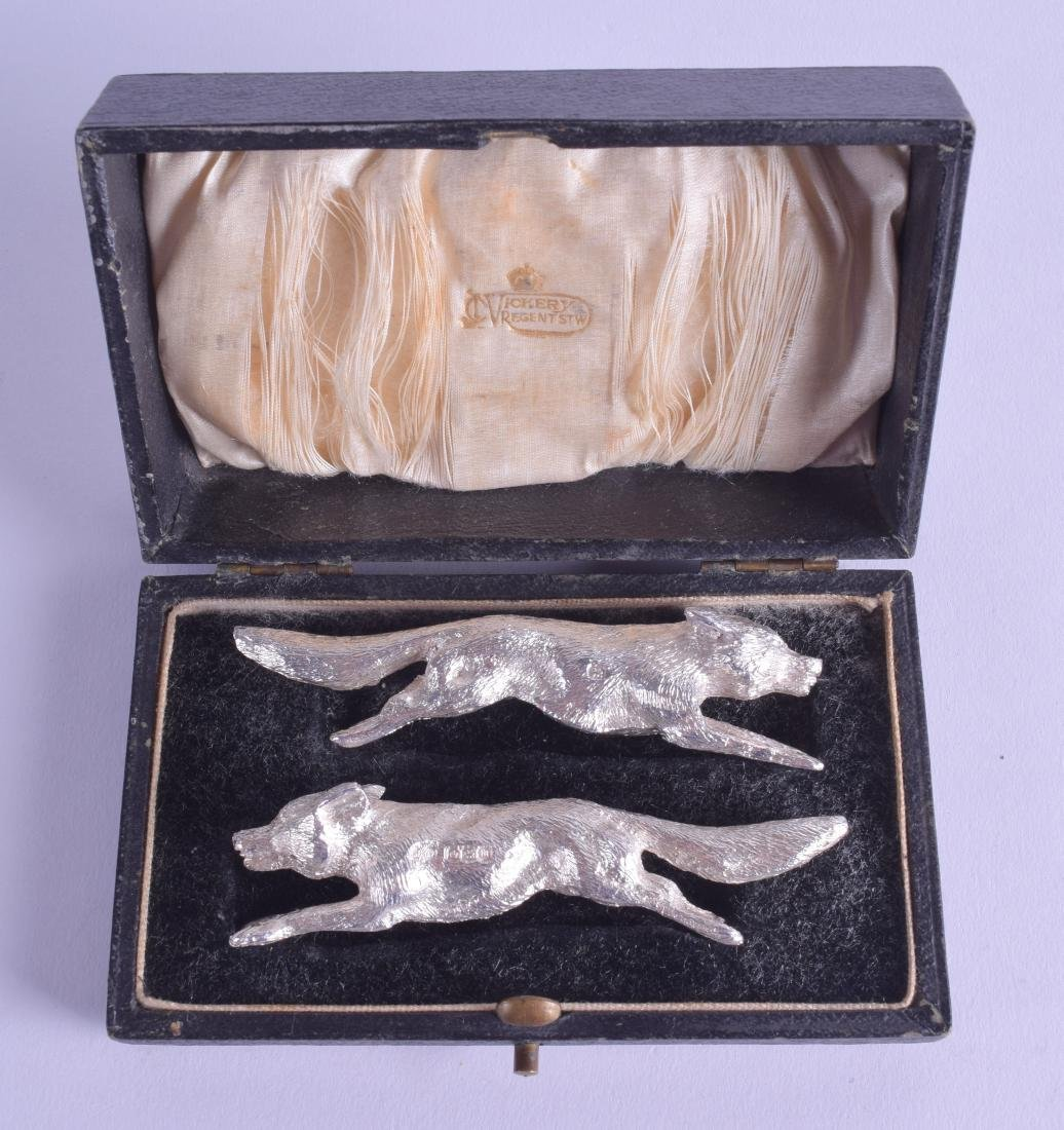 A RARE PAIR OF BOXED SILVER KNIFE RESTS in the form of