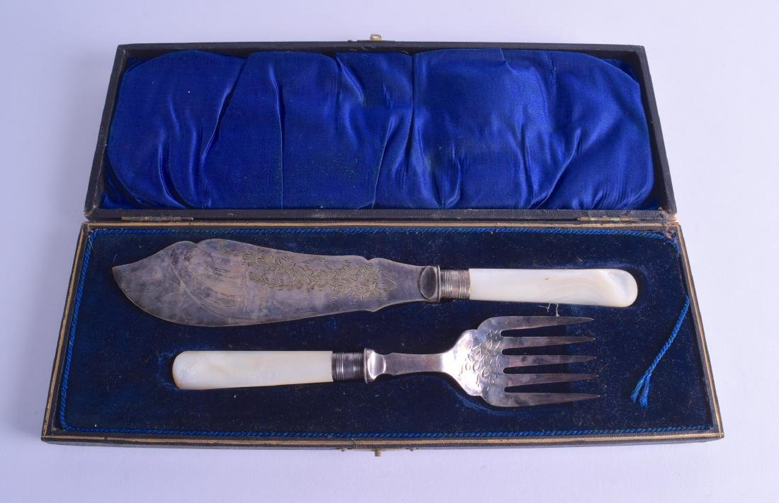 A CASED PAIR OF ANTIQUE SILVER CAKE SERVERS with mother