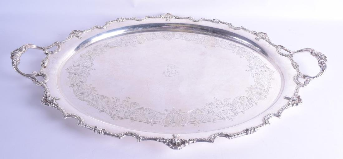 A HEAVY TWIN HANDLED SILVER SERVING TRAY engraved with