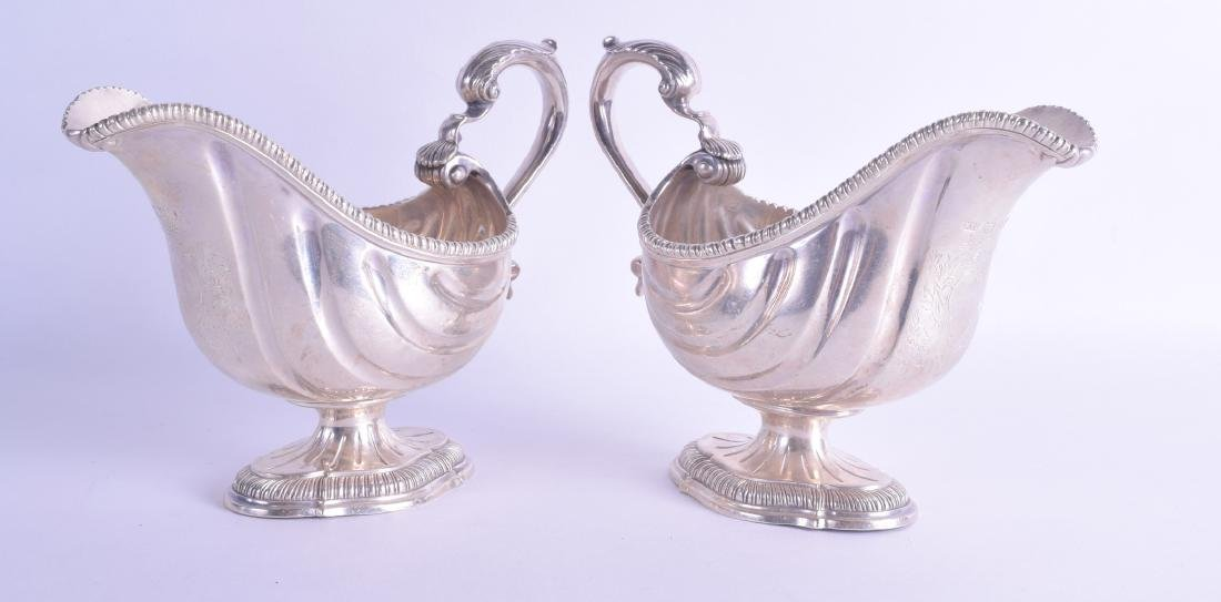 A GOOD PAIR OF EDWARDIAN SILVER SAUCE BOATS George III