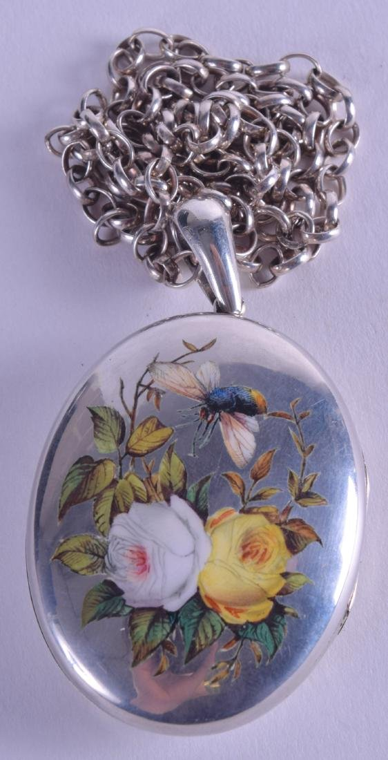 A FINE LATE VICTORIAN SILVER AND ENAMEL LOCKET