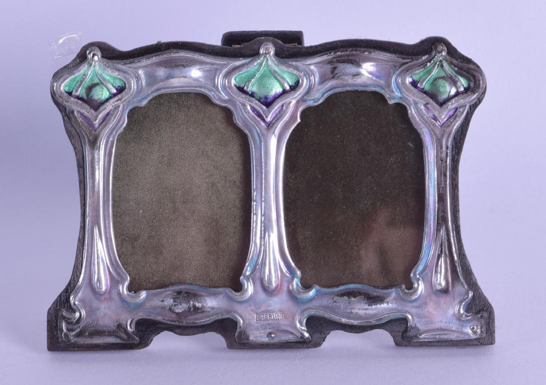 A STERLING SILVER AND ENAMEL DOUBLE PHOTOGRAPH FRAME.
