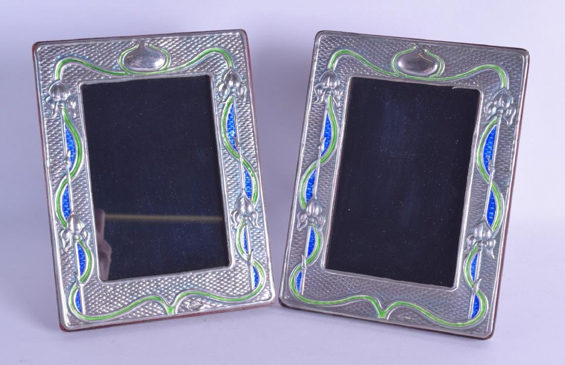 A PAIR OF STERLING SILVER AND ENAMEL PHOTOGRAPH FRAMES