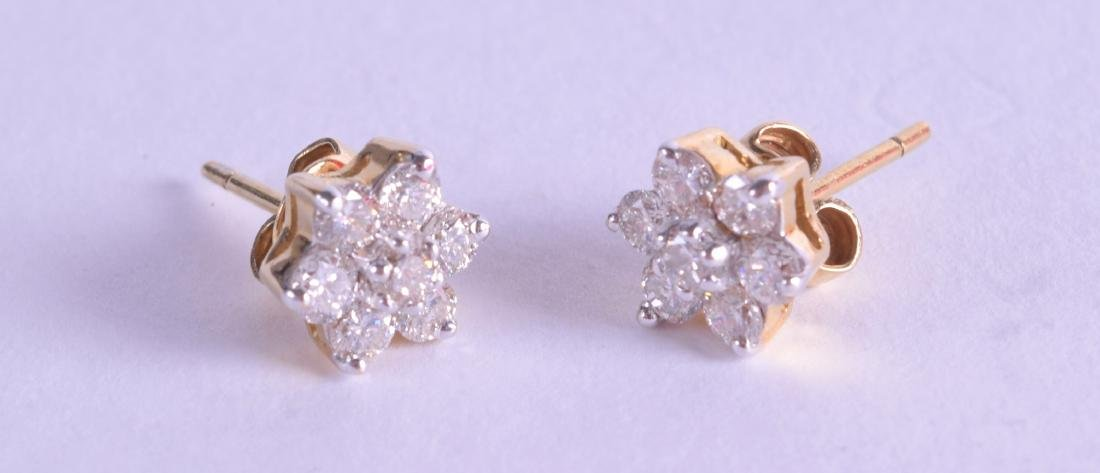 A PAIR OF 18CT GOLD AND DIAMOND EARRINGS. 11.6 grams.