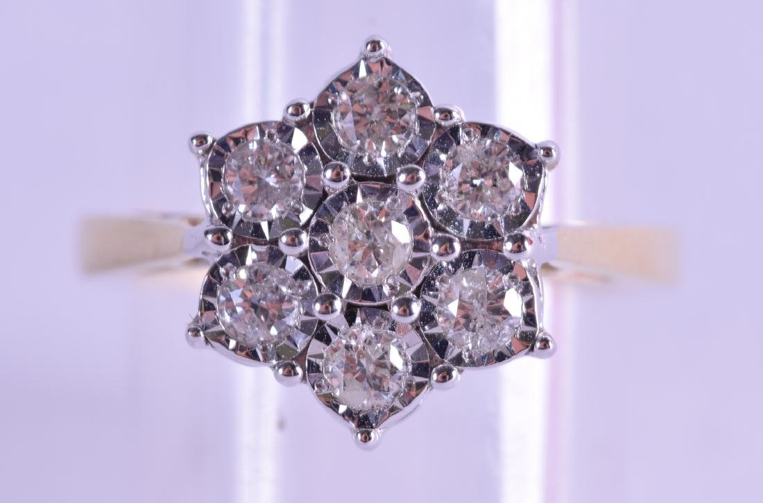 A 9CT GOLD AND DIAMOND DAISY CLUSTER RING. Size N.
