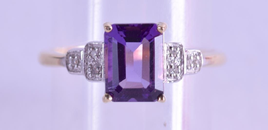 A 9CT EMERALD CUT DIAMOND AND AMETHYST RING. Size N.
