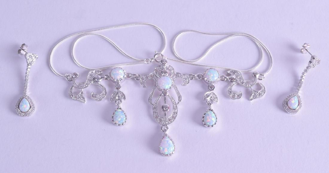 A PAIR OF SILVER AND OPAL EARRINGS with matching
