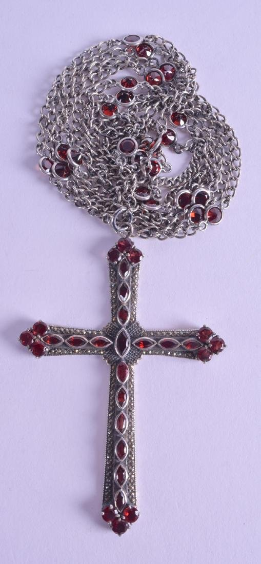 A LARGE SILVER AND GARNET CRUCIFIX NECKLACE.