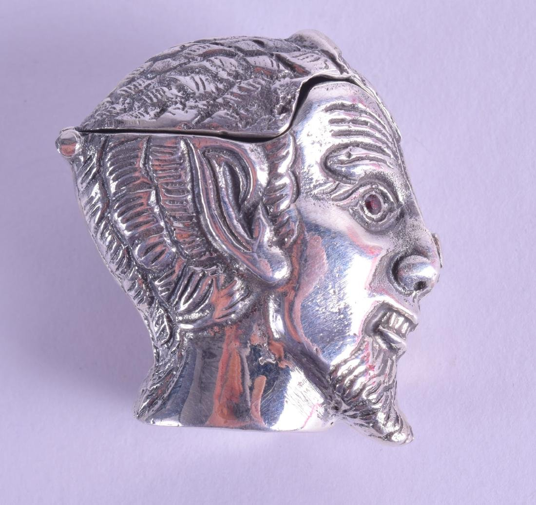 A NOVELTY SILVER DEVIL HEAD VESTA CASE.