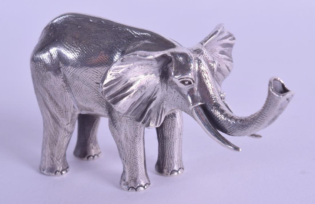 A NOVELTY SILVER ELEPHANT. 8 cm wide.