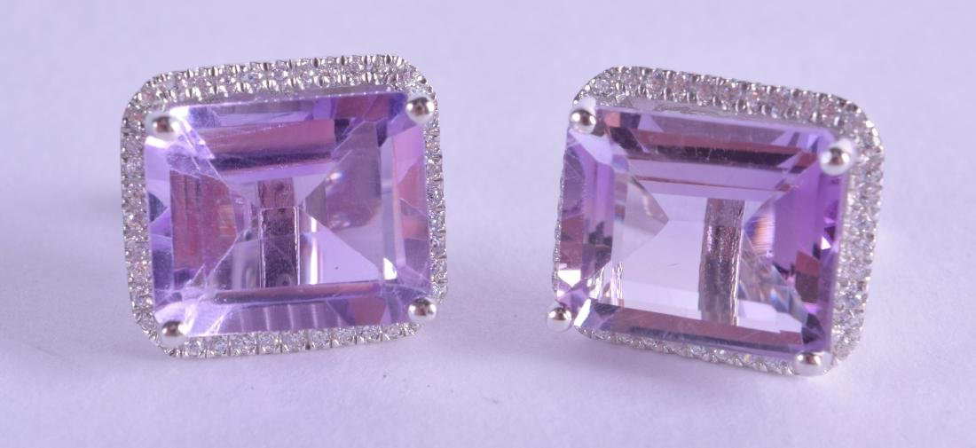 A PAIR OF SILVER SQUARE CUT AMETHYST EARRINGS.