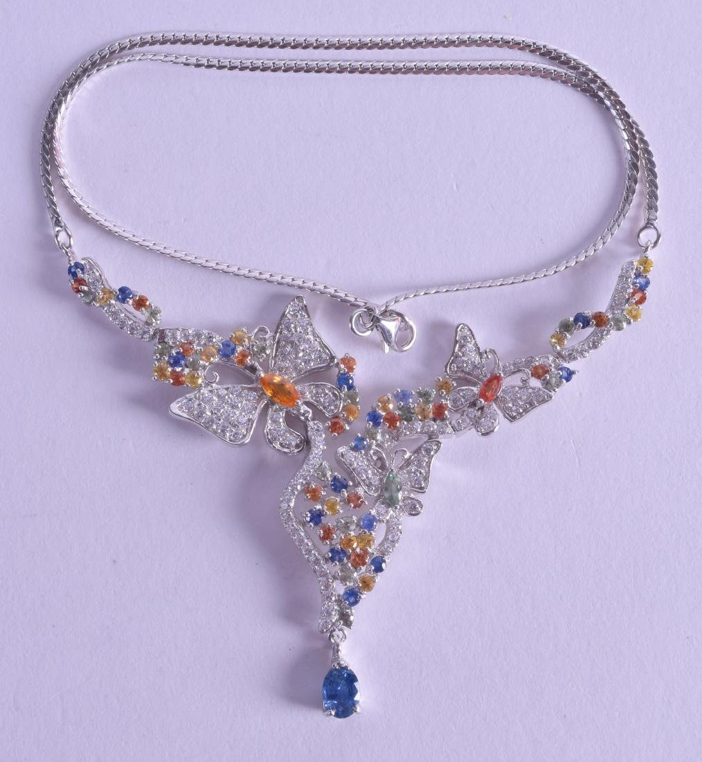 A SILVER MULTI COLOURED SAPPHIRE BUTTERFLY NECKLACE.