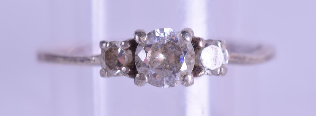 AN ANTIQUE PLATINUM AND DIAMOND RING. Size Q.