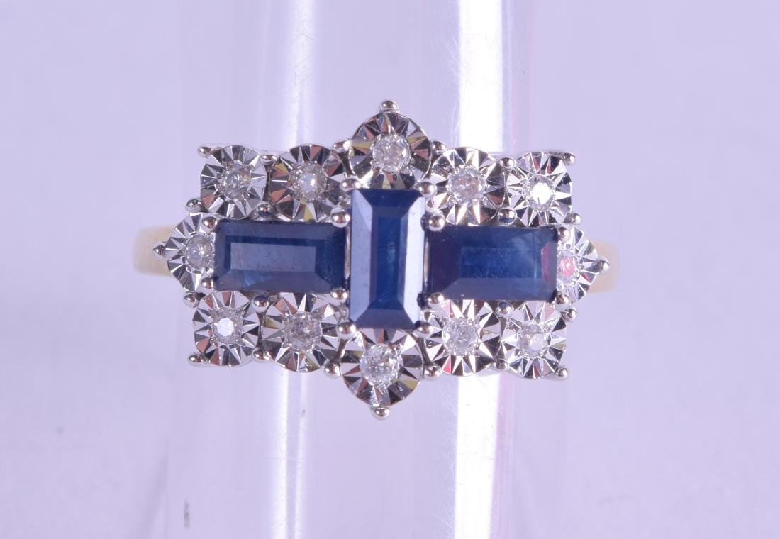 A 9CT GOLD BAGUETTE CUT DIAMOND AND SAPPHIRE RING. Size