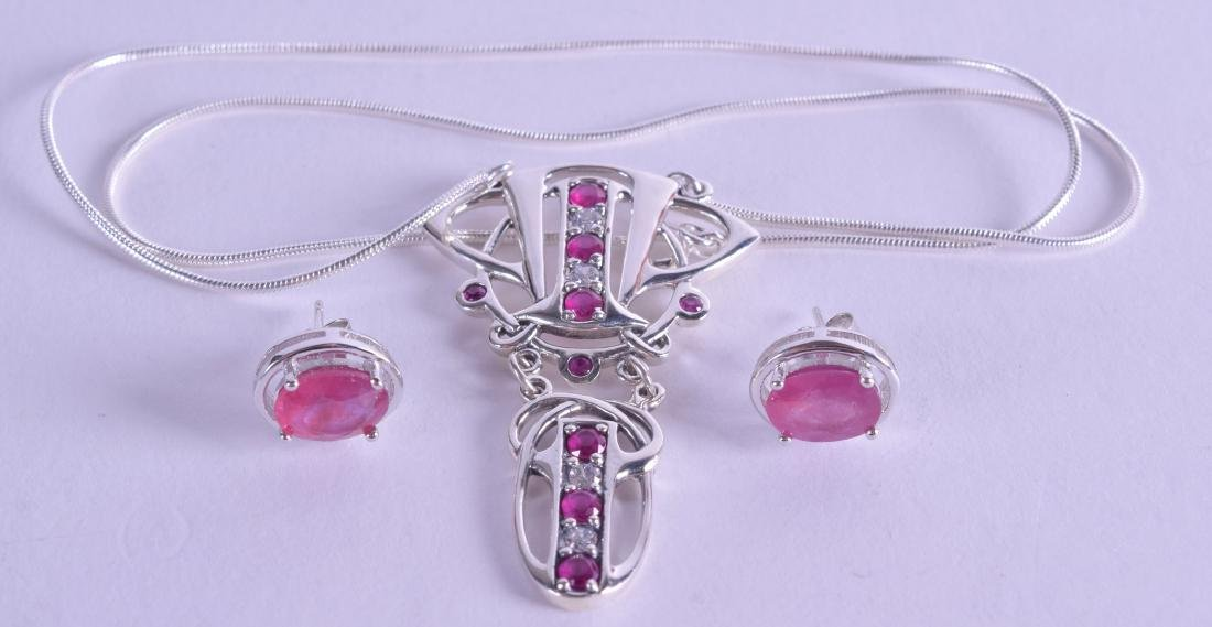A PAIR OF SILVER AND RUBY EARRINGS together with