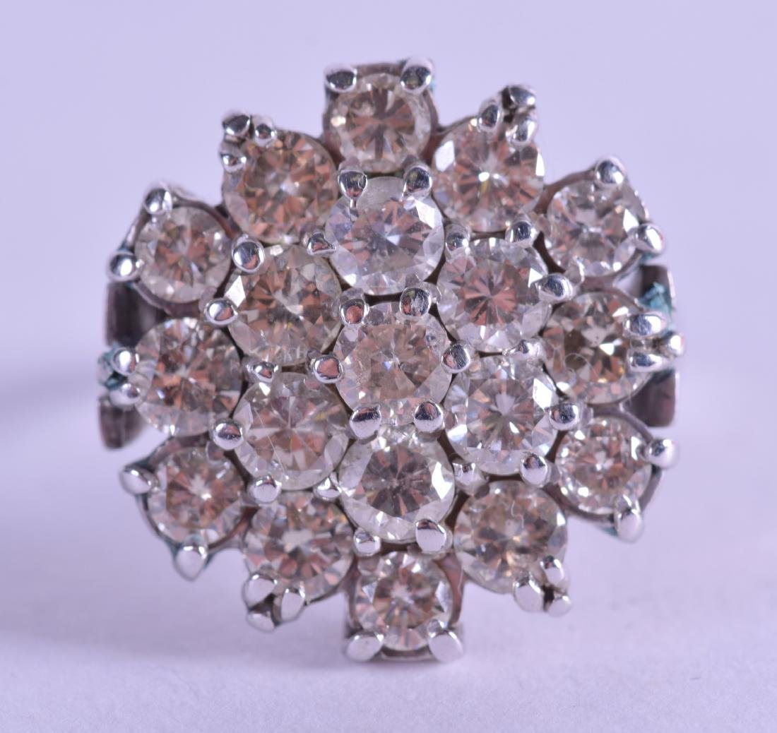 AN 18CT WHITE GOLD AND DIAMOND CLUSTER RING comprising
