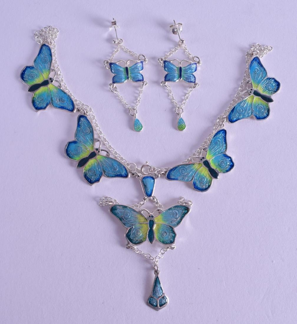 A SILVER AND ENAMEL BUTTERFLY NECKLACE with matching