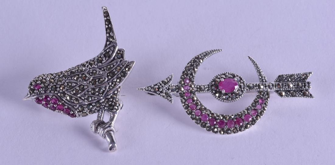TWO NOVELTY SILVER AND MARCASITE BROOCHES. (2)