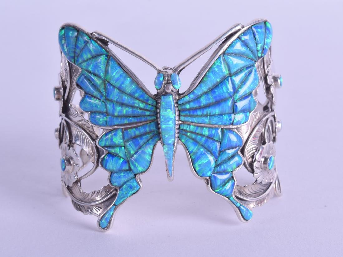 A SILVER AND ENAMEL BUTTERFLY BANGLE.