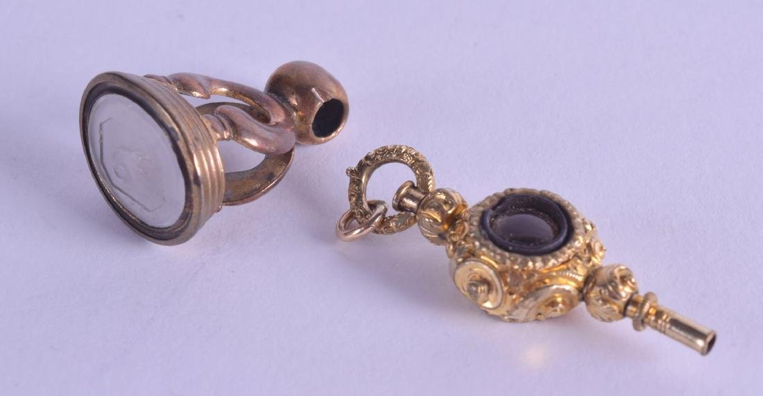 A MID 19TH CENTURY YELLOW METAL WATCH FOB together with