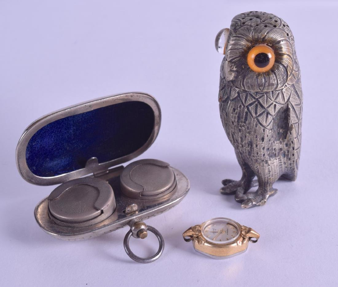 A NOVELTY WHITE METAL OWL PEPPERETTE together with a