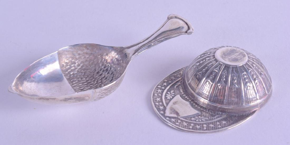 TWO NOVELTY SILVER CADDY SPOONS. (2)