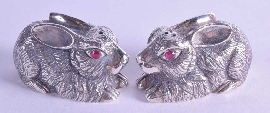 TWO NOVELTY SILVER AND RUBY EYE CONDIMENTS. (2)