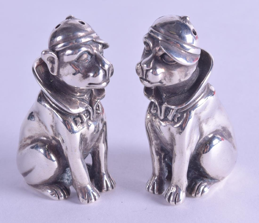 A PAIR OF NOVELTY SILVER DOG CONDIMENTS.