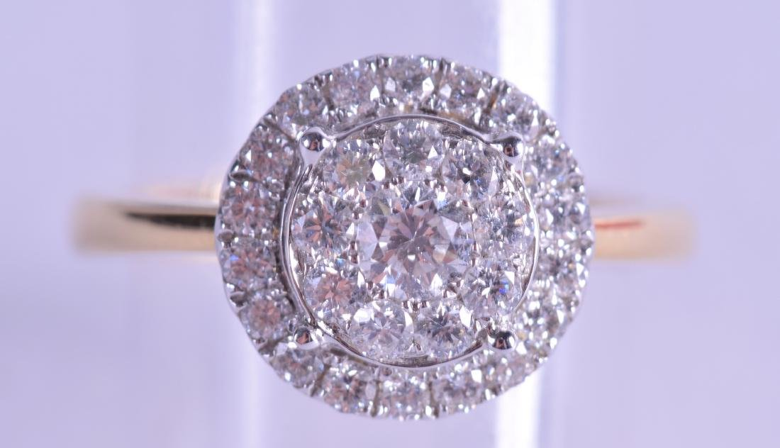 A GOOD 18CT GOLD AND DIAMOND CLUSTER RING. Size O/P.