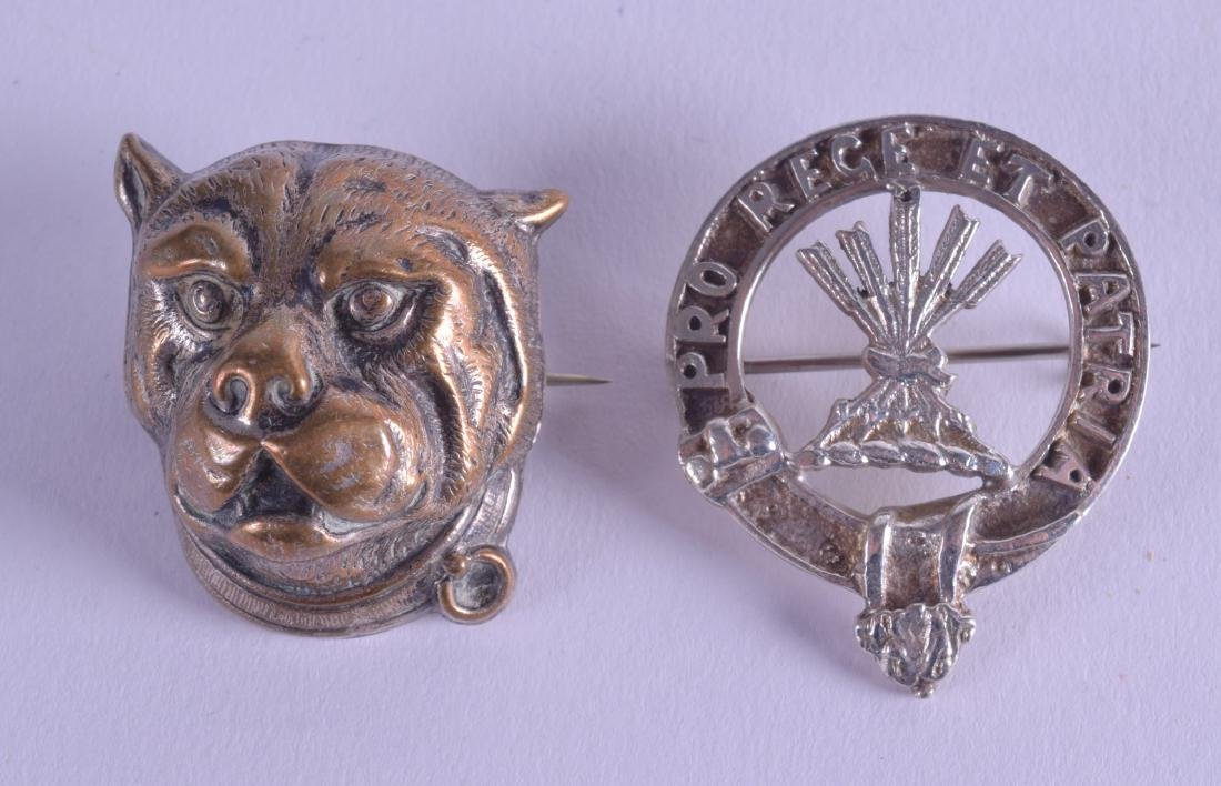 AN UNUSUAL HIGHLANDS WHITE METAL BROOCH together with a